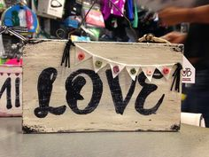 love of course! wooden sign