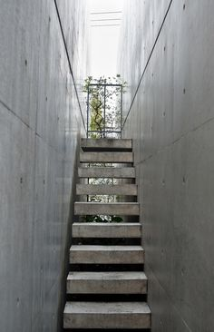 Stairs framed by large forms. Church of Light Osaka Japan - Tadao Ando.