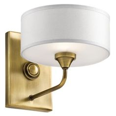 This 1 Light Wall Sconce In Natural Brass From The Lucille Collection Is A Stand Out With Its Transitional Design Making It The Perfect Selection For Any Dcor. It Features A Rich Auburn Stained Wood Center Column And A Simple Yet Beautiful White Fabric Shade.