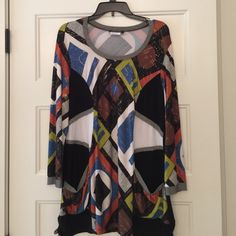 "Long sleeve tunic Long sleeve tunic length top. Great for leggings or skinny jeans. Measures 30"" in length. There is a gold metallic shimmer to this top as well. Pockets on the bottom and drawstrings on the sides. In excellent condition. Bali Tops Tunics"