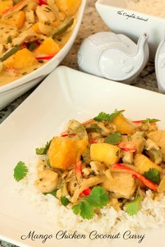 Mango Chicken Coconut Curry ~ A little bit spicy and creamy, and a whole lotta delicious, this Thai-inspired curry is loaded with chicken and mango.