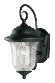This one-light wall lantern is the embodiment of traditional refinement with its beautiful steel scroll arm and frame with vintage bronze finish. Clear crackle glass slopes handsomely into an inverted