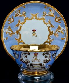 Antique Russian Imperial Porcelain Cup And Saucer from the Banquet service of the Peterhof palace near St Petersburg. Both pieces are painted with a gold cipher of Tsarevich Alexander. Made at the Imperial porcelain factory during the reign of Tsar Alexander III.