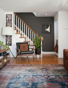 42 Mid Century Modern Designs To Fall For - Cool chair, traditional rug with mid-century pieces
