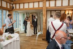 Mr & Mrs make their entrance at Vaulty Manor, Essex, reportage - documentary-style photography by Jayne Heather - Wedding Photojournalism