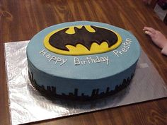 batman birthday cake for a 2 year old boy. logo and buildings made of fondant.