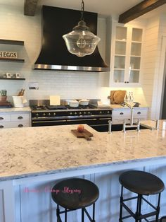 Touring a French farmhouse with brick backsplash and lacanche range