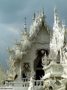 Wat Rong Khun buddhist temple in Chiang Rai, Thailand. The sanctuary was conceived by acclaimed Thai artist Chalermchai Kositpipat, and is of such staggering complexity that it is estimated the building will need almost 100 more years to complete its construction.