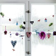 Window Decor Ideas for Christmas. Cute in the kitchen with gingerbread men and other cookie or treat ornaments.