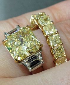 A yellow diamond and diamond engagement ring with a yellow diamond eternity band. Both by Sasha Primak. Via Diamonds in the Library.
