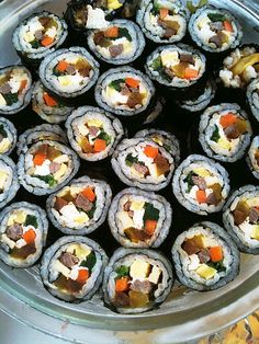 """Kimbap"" literally means ""Seaweed Rice"". My mother often made this for lunch, especially when it was hot outside or if we were travelling for one of our day trips. It is basically like sushi but usually with grilled meat, carrots, spinach, egg and daikon radish instead of raw fish."