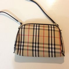 NWOT Stripped Clutch with Detachable Strap Strap comes off so this can be carried as a small cultch or small cross body purse. Clutch has a zippered inside pocket. Zippered top. Bags Clutches & Wristlets
