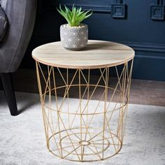 Add some style & unique storage to your living room with this Tromso Basket Side Table. Contemporary metal table has a removable top - B&M Stores. Tromso, Living Room Furniture Online, Living Rooms, Side Tables Bedroom, Home Decor Baskets, Small Coffee Table, Coffee Tables, Glass End Tables, Color Dorado