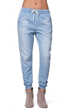 """The women's Bullhead Denim Co Drawcord Sunny Jogger Pants for PacSun and PacSun.com features a faded light wash throughout and a comfortable drawstring waistband. We love the relaxed fit and super soft fabric. Wear these joggers with our tank or sweaters, and throw on a pair of ankle boots! High rise 12"""" rise 28"""" inseam Measured from a size small Model is 5'9"""" and wearing a small 100% cotton Machine washable Imported"""