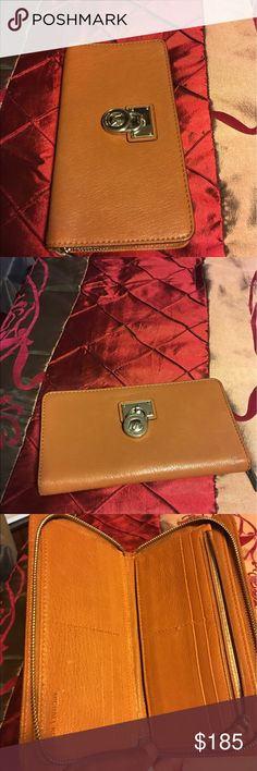 Michael kors wallet Excellent condition used zip around large wallet lots of credit cards slots zipper inside Michael Kors Bags Wallets