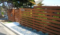 Fencing was needed to screen this Row home in Pacific Beach, CA. Horizontal Cedar with wide gaps to allow light into the shady patio. A sliding gate creates additional privacy and security. Modern style house numbers were added to complete the look. Japanese inspired rock and moss garden.