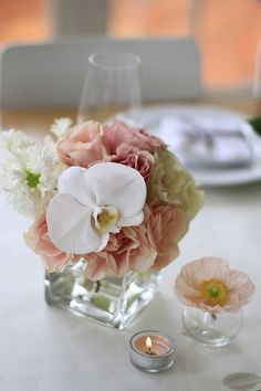 love the pastels and the mix of modern flower in an otherwise traditional piece.