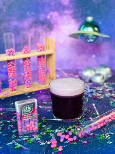 This Tic Tac Big Berry Adventure inspired cocktail is out of this world! To create, make a mixed berry simple syrup using a 1/2 cup of blueberries, 1/2 cup of raspberries and 1 cup of sugar. Add ingredients to a saucepan. Heat on low until simmering, and stir. Strain and let cool. Grab a cocktail shaker and add 1oz gin, 1oz blue curaçao, 1oz berry syrup, 1oz lime juice, .75oz egg whites and four ice cubes. Shake and strain into a glass. Must be 21 and older to enjoy. (Credit: @bestdayoftheweek_) Purple Alien, Blue Curacao, Thing 1, 31 Days Of Halloween, Monster Mash, Simple Syrup, Diy Costumes, Lime Juice, Family Activities