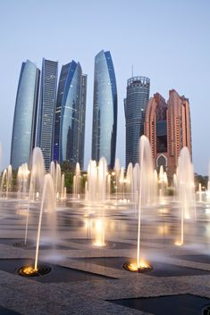 Etihad Towers, Abu Dhabi viewed from the Emirates Palace Hotel fountains.