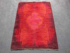Reddish goodness in this Vintage Loomed 1960's Modern Desso Shag Rug for sale by BOMALI on Etsy, $265.00
