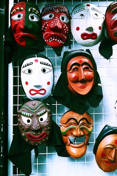 Old expressions - 'Tal' are masks Korean traditional masks. The masks were often made of alder wood, with several coats of lacquer to give the masks gloss, and waterproof them for wearing. They were usually also painted, and often had hinges for mouth movement. Now a days, they're used as miniature masks for tourist souvenirs, and hung on cell-phones for good luck.