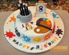 Artist's cake with handmade brushes, easel and paints