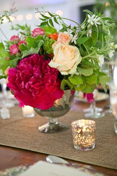 Centerpieces - wild and oversize blooms mixed with LOTS of greens - LOVE. Not sure on the metallic vessels