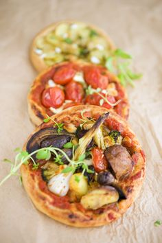 veggie mini pizzas | These pizzas are inspired from that sicilian restaurant, but instead of making one giant pizza we made mini versions. It has probably been said a zillion times before, but this is a great thing to do for a party. Prepare all the ingredients and a big batch of pizza dough (you can prepare the dough the day before), then let everyone decorate their own pizza. | #food