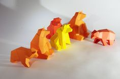 """Mini Papercraft Kits """"Sitting Bear Family"""", developed for a group event. Each bear consists out of 2 elements and no instructions at all. Participants where still able to put together the animals."""