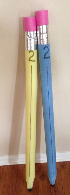 Giant pencils for Back to School photo op!  Pool noodles, duct tape, and wooden dowel -- 15 minutes!