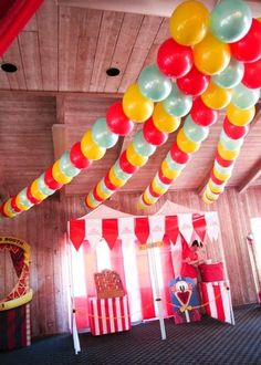 balloon garlands...run a threaded needle through the tied end of the balloon to string them together - no helium required   can be made ahead of time.