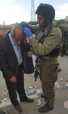 ONLY IN ISRAEL!! Palestinian man being treated by Israeli forces after being stoned by Arabs