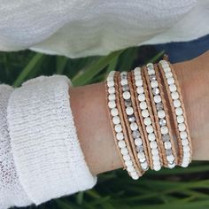 This bracelet features white howlite and crystals handwoven onto natural leather. Bracelet includes an engraved Katie Joëlle clasp and wraps around the wrist five times with four adjustable closures f