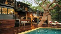 Got to love houses that integrate nature with the whole look and feel.