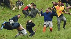 Cheese-rolling spectators gather for Cooper's Hill tradition - BBC News Chris Anderson, Cheese Rolling, Bbc News, Victorious, Rolls, England, Racing, Gloucester, Traditional