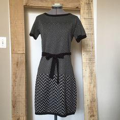 """BOGO 1/2 Off Sale! CK Gray & Black Sweater Dress BOGO 1/2 Off Sale! Calvin Klein Gray & Black Chevron Sweater Dress. In like new condition. Size M measures flat: 14"""" across shoulders, 18"""" across chest, 16"""" across waist, 20"""" across hips, 34"""" long. 100% acrylic. 302/400/041016 **Lesser item will be half. See details in sale listing. Valid only in my closet on items $10 or more. Calvin Klein Dresses"""