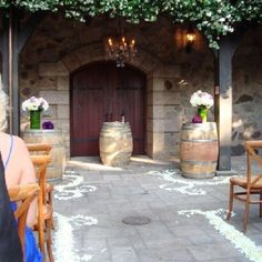 Ceremony and altar florals and decor... In case you don't have enough use for all your extra wine barrels =)