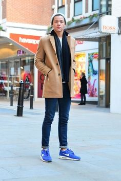 Perfect the smart casual look in a camel pea coat and navy slim jeans. Grab a pair of blue athletic shoes for a more relaxed aesthetic.  Shop this look for $235:  http://lookastic.com/men/looks/beanie-crew-neck-t-shirt-scarf-pea-coat-skinny-jeans-athletic-shoes/5073  — Grey Beanie  — White Crew-neck T-shirt  — Navy Scarf  — Camel Pea Coat  — Navy Skinny Jeans  — Blue Athletic Shoes