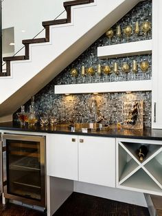 This wet bar with wine storage is great use of under the stairs space!