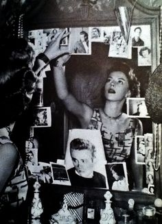 Natalie Wood puts up photographs of James Dean in her dressing room after his death