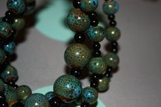 $20.00 This 3 strand bracelet reminds me of the color of mermaid scales and the ocean, hence the name. The middle strand is slightly thicker than the other two making for an interesting combination. Also check out and like me on FB, http://www.facebook.com/MeeshPieces