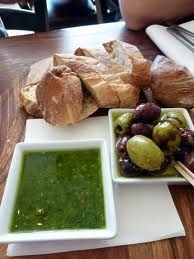 Bread and olives with pesto - yum!