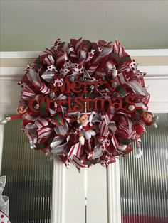 Merry Christmas wreath with candy canes created by Ronda cromeens 55$