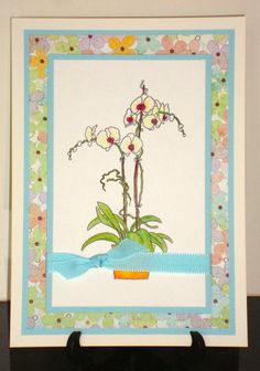 Birthday card made with the Stampendous Orchid Greetings stamp, Basic Grey designer paper and watercolor pencils.