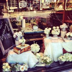 window display styled by @Petite Pearl Events + florals by @Celsia Florist.