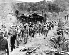 American and Filipino prisoners of war captured by the Japanese are shown at the start of the Death March after the surrender of Bataan on April near Mariveles in the Philippines. Starting from Mariveles on April some American and Fili Us Marines, Nagasaki, Hiroshima, Filipino, Bataan Death March, Powerful Pictures, Iwo Jima, San Fernando, Prisoners Of War
