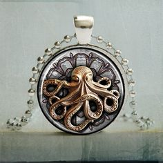 This art pendant is handcrafted featuring a Steampunk bronzed Octopus. Makes a perfect gift for Steampunk fans and nautical lovers.  Details:  • Pendant measures 25mm x 3mm • Back of the pendant has a swirl geometric design • The laser printed image is co