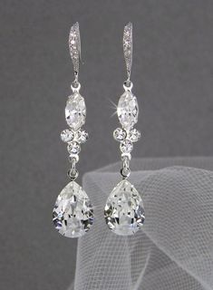 Hey, I found this really awesome Etsy listing at http://www.etsy.com/listing/93843415/dangle-crystal-bridal-earrings-wedding