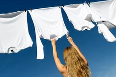 Photo about Longhaired young woman reaching white laundry which hangs to dry in a summer breeze on a clothes-line. Image of clothespins, energetic, line - 1674676