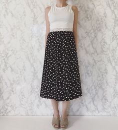 ⤷ shop update today: 1970s polka dot pleated midi skirt / vintage black pleated accordion skirt with white polka dots / s / m / $52 #vintage #vintageshop #vintageskirt #polkadotskirt #1970s #70s